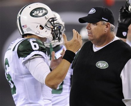 Jet's QB Mark Sanchez explains to coach Rex Ryan why he called for a timeout with 1:20 to go in the 1st half. Photo: AP