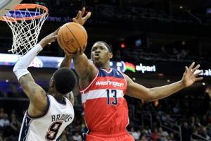 #13 Kevin Seraphin blocks a shot by Brooklyn Nets guard Marshon Brooks. (AP Photo/Mel Evans)