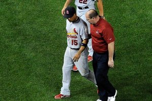 Rafael Furcal #15 of the Cardinals walks off the field with manager Mike Matheny and trainer Greg Hauck during a game vs the Nationals last August after he felt something 'Pop' in his elbow. Photo by Patrick McDermott/Getty Images