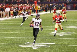 #12 Jacoby Jones runs in for the TD at the opening of the 3rd quarter on a 108 yard kickoff return. Photo:  REUTERS/Gary Hershorn (UNITED STATES