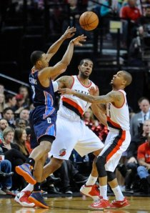 #^ PG Eric Maynor (on far right) dished out a career high12 assists in his 1st game with Portland. AP Photo/Greg Wahl-Stephens