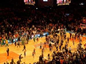 Swarms of players and fans burst onto the Garden floor following the KNicks game 1 victory. Photo: fantasyfurnace.com