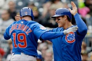 #19 Nate Schierholtz celebrates with teammate Anthony Rizzo after hitting a 2-run HR. He has 2 on the year to go along with2 SB & a .363 BA. Photo: Associated Press