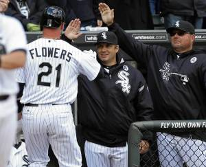 #21 Tyler Flowers gets some high fives from his teammates after hitting his 1st HR of the season off of Jamie Shields. Photo: Scott Strazzante, Chicago Tribune