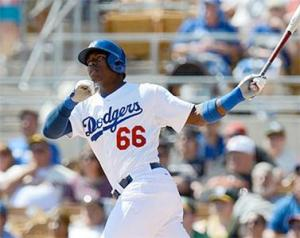 #66 Top prospect Yasiel Puig launches one of his four homers in the first week in the big leagues. Photo by USA Today Sports