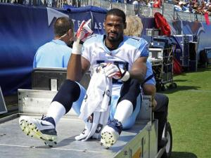 #10 Kenny Britt shoewn here being carted off the field witha torn ACL & MCL in 2011 has had injury & legal issues throughout his career. Photo:  George Walker IV, AP