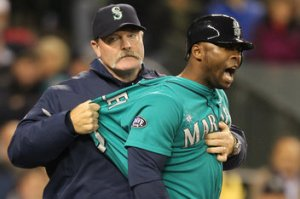 #15 Milton Bradley being restrined by manager Eric Wedge after another in a series of ejections for the disgruntled OF. Photo by Otto Greule Jr/Getty Images