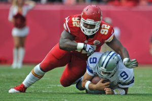#92 Nose tackle Dontari Poe levels Tony Romo after a small gain on Sunday. Photo: Peter Aiken/Getty Images