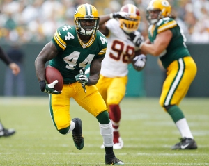 #44 James Starks plows ahead for 7 of his 132 yards vs the Redskins on Sunday. Photo: (Mike Roemer/AP)
