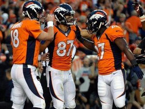 #18 Peyton Manning congratulates #87 Eric Decker after scoring a touchdown vs the Raiders in Denver on MNF 9/23/13 AP Photo/Jack Dempsey