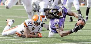 #14 Marlon Brown eludes #21 CB Chris Owens of the Browns in a game earlier in the season. Photo: Associated Press