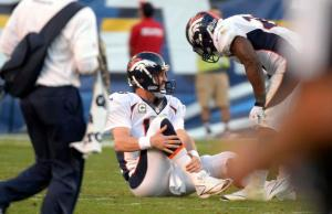 #18 Peyton Manning grimaces after getting hit vs the Cargers at QualcommStadium. He'll be more than able this Monday Night vs the undefeated Chiefs. John Leyba, The Denver Post: