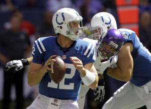 #12 Andrew Luck shown here in his 1st win as a Colt, 23-20 over the Vikings some 14 months ago. Hey, Peyton didn't win his 1st game...Photo: Michael Conroy/AP