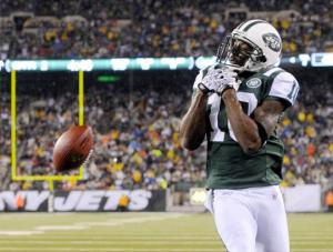 #10 Santonio Holmes drops a pass vs the Miami Dolphins. He hasn't lived up to all Photo: Charles Wenzelberg hype in N.Y. Photo: