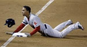 #72 Xander Baegarts slides safely into third base after tripling in game three of the 2013 World Series. Photo: AP