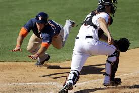 OF George Springer about to make one of his patented head-first slides into home plate will prove to be one exciting ballplayer to keep your eyes on this season. Photo: AP