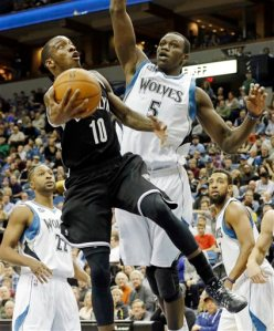 #5 Gorgui Dieng blocks Nets' Tyshawn Taylor from making an easy layup. Dieng could see extended playing time as Nikola Pekovic has had ankle issues in the past says the Furnace. Photo: AP